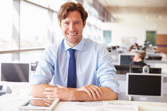 Male architect sitting at his desk in an office Stock Photography