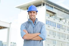 Male architect standing arms crossed outside building Stock Photos