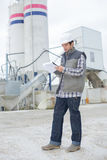 Male architect standing near factory outdoors Royalty Free Stock Photo