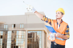 Male architect standing outside building Royalty Free Stock Photo