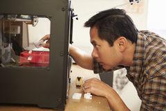 Male Architect Using 3D Printer In Office. Making Model Stock Photos