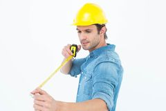 Male architect using tape measure. Over white background Royalty Free Stock Images