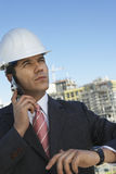 Male Architect Wearing Helmet On Call Royalty Free Stock Image