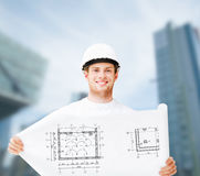 Male architect in white helmet with blueprint Stock Image