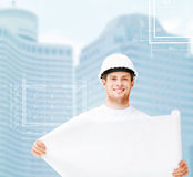 Male architect in white helmet with blueprint Royalty Free Stock Images