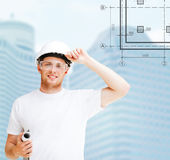 Male architect in white helmet with blueprint Royalty Free Stock Photography