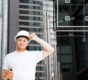 Male architect in white helmet with blueprint Stock Images