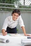 Male Architect Working On Blueprint Stock Photos