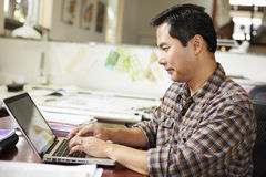 Male Architect Working At Desk On Laptop Royalty Free Stock Images