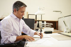 Male Architect Working At Desk In Office stock photography