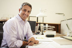 Male Architect Working At Desk In Office Royalty Free Stock Photo