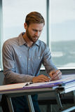 Male architect working in office. Young male architect working in office Royalty Free Stock Image