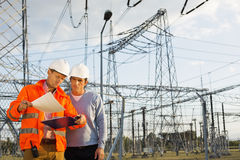 Free Male Architects Reviewing Documents Together At Electric Power Plant Stock Images - 35917264