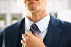 Male arm in blue suit set tie closeup Royalty Free Stock Photography