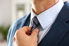 Male arm in blue suit set tie closeup Royalty Free Stock Photos