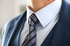 Male arm in blue suit set tie closeup Stock Photo