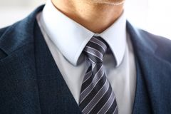 Male arm in blue suit set tie closeup Stock Photos