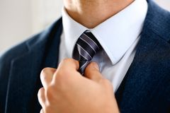 Male arm in blue suit set tie closeup. White collar management job serious move secretary student luxury formal interview executive agent marriage store Royalty Free Stock Image