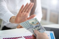 Male arm pay bunch of hundred dollars bills stock images