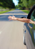 Male arm sticking out of the car Stock Images