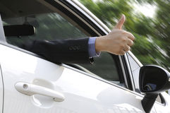 Male arm sticking out of the car Royalty Free Stock Image