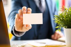 Male arm in suit give blank calling card Royalty Free Stock Image