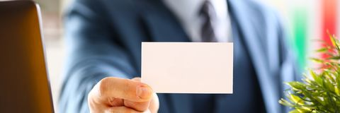 Male arm in suit give blank calling card Royalty Free Stock Photos