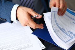 Male arm in suit offer insurance form clipped to pad. And silver pen to sign closeup. Strike a bargain, driver money loss prevention, secure road trip, harmless Stock Photography