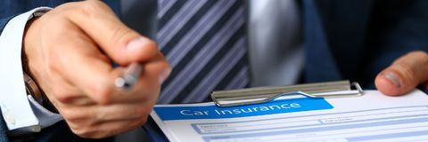 Male arm in suit offer insurance form clipped to pad. And silver pen to sign closeup. Strike a bargain, driver money loss prevention, secure road trip, harmless Royalty Free Stock Image