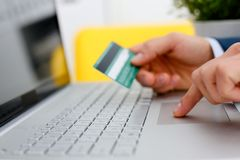 Male arms hold credit card press buttons. Making transfer closeup. Anti-fraud financial security when entering client discount program number or filling Stock Photography