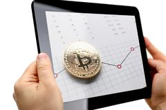 Male arms hold tablet pc with btc sign coins. At stats display closeup. Modern pay and buy system symbol idea virtual earning and anti fraud transactions broker Royalty Free Stock Images