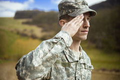 Saluting male army soldier Royalty Free Stock Image