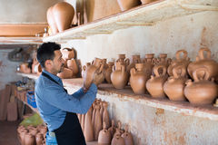 Male artisan in ceramic workshop Stock Photo