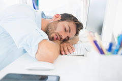 Male artist with head resting on keyboard Stock Photo