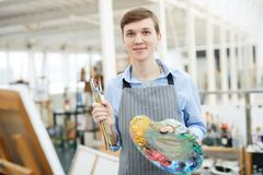 Male Artist Holding Palette stock photography