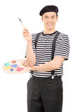 Male artist with paintbrush and a color palette Royalty Free Stock Image