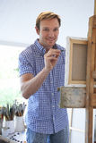 Male Artist Painting In Studio Stock Image