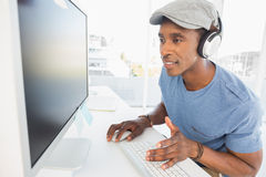 Male artist using computer in the office Stock Images
