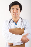Male asian doctor. Portrait of a young male asian doctor holding clipboard Stock Photography