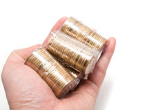 Male Asian hand holding a bunch coins Royalty Free Stock Images