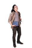 Male Asian Student Thinking. Photo image portrait of a cute young Asian male student with long hair, looking up, standing and thinking while holding books, full Royalty Free Stock Images