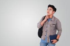 Male Asian Student Thinking Stock Photo