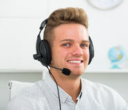Male assistant with headphones indoors Stock Images