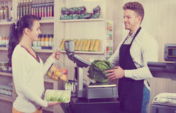 Male assistant helping customer in grocery shop Royalty Free Stock Image
