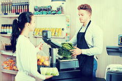 Male assistant helping customer in grocery shop Stock Photos