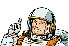 Male astronaut pointing up, isolate on white background. Pop art retro vector illustration kitsch vintage drawing Stock Photography