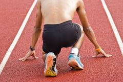 Male athlete all set before race starts. Stock Photo