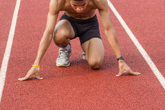 Male athlete all set before race starts. Royalty Free Stock Images