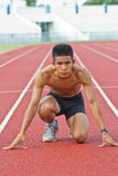 Male athlete all set before race starts. Stock Photos