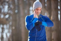 Athlete on cardio training in nature. Male athlete on cardio training measures pulse Stock Images